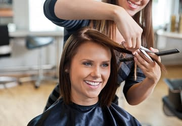 Woman getting a haircut